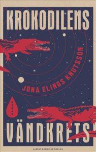 Omslag i rött blått och vitt till boken Krokodilens vändkrets